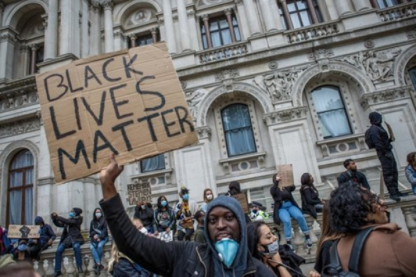 A protester holding a BLM placard during a London demonstration. Press Association